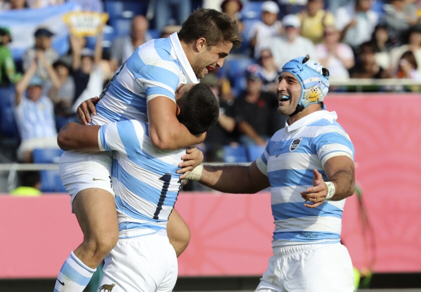 Argentina's Juan Cruz Mallia is congratulated by teammates after scoring a try during the Rugby World Cup Pool C game at Kumagaya Rugby Stadium between Argentina and the United States in Kumagaya City, Japan, Wednesday, Oct. 9, 2019. (AP Photo/Eugene Hoshiko)