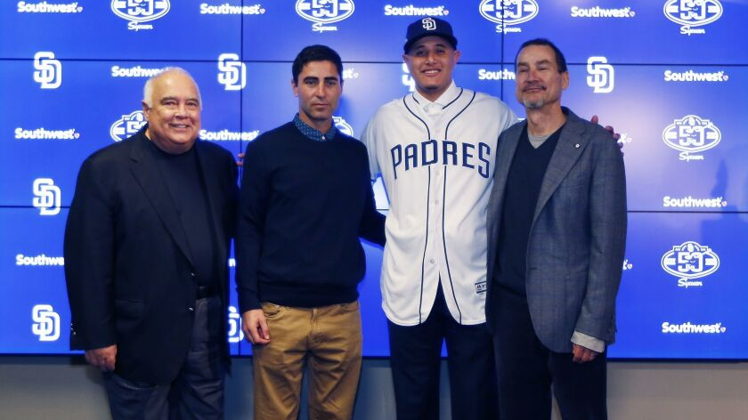 From left: San Diego Padres Executive Chairman Ron Fowler, General Manager A.J. Preller, infielder Manny Machado and General Partner Peter Seidler. Machado signed a 10-year, $300 million contract with the Padres.