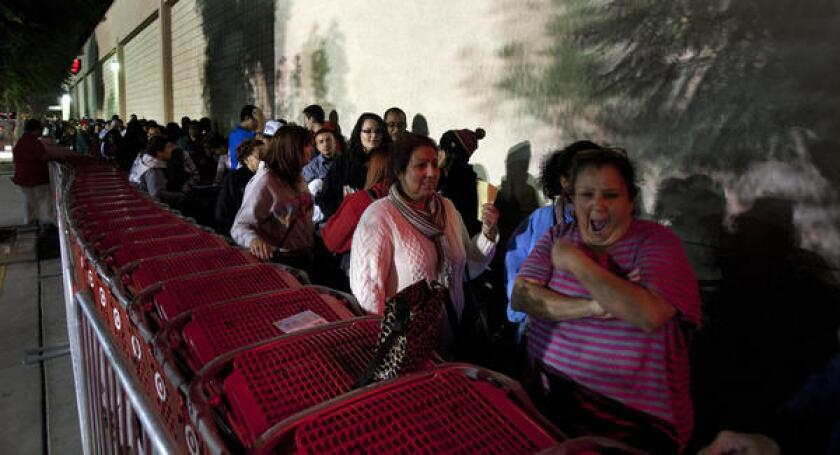 Last year, shoppers waited in line at a Target store in Riverside on Thanksgiving evening; this year, Target and others are opening even earlier on the holiday.
