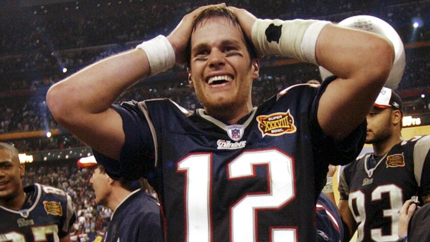 Quarterback Tom Brady celebrates after New England beat Carolina in Super Bowl XXXVIII in February 2004.