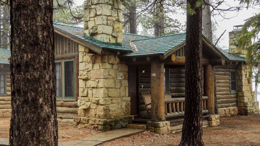 Dozens of cabins are dotted amid tall pine trees along the North Rim of the Grand Canyon. Some offer