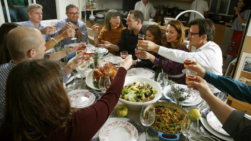 Friends and family gather for chef Adam Perry Lang's Thanksgiving feast.