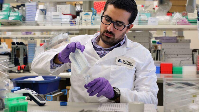 In a lab at Ionis Pharmaceuticals, temporary scientist Ben Kiaei works with extracted RNA from tissue samples. He's working on the Neuroscience Drug Discovery team to develop therapies for diseases o