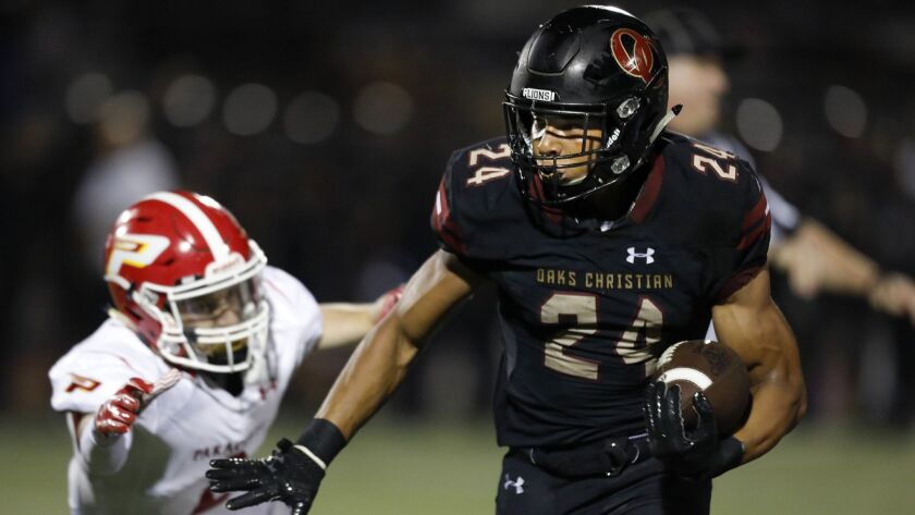 Running back Zach Charbonnet (24) of Oaks Christian is committed too Michigan.