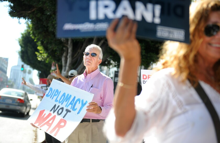 MoveOn members including Robin Doyno of Mar Vista, left, gather in front of Rep. Lieu's office in Los Angeles to urge him to support the Iran Deal on August 26.