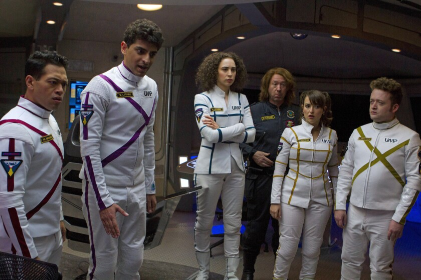 """Eugene Cordero (left), Karan Soni, Bess Rouse, Joel Hodgson, Milana Vayntrub and Neil Casey crew a starship lost in another universe in Paul Feig's sci-fi comedy """"Other Space,"""" now on Yahoo Screen."""