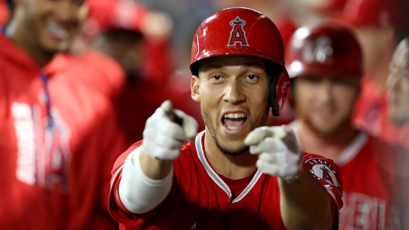 ANAHEIM, CALIF. - JUNE 28, 2017. Angels shortstop Andrelton Simmons celebrates in the dugout after