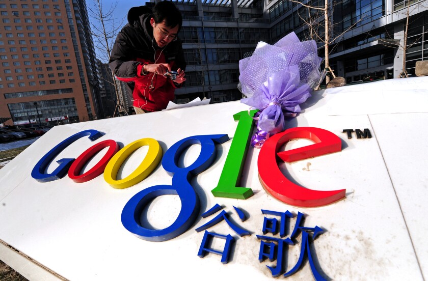 A bouquet of flowers lay upon the company logo outside the Google China headquarters in Beijing on Jan. 14, 2010. Google stopped mainland search in China that year.