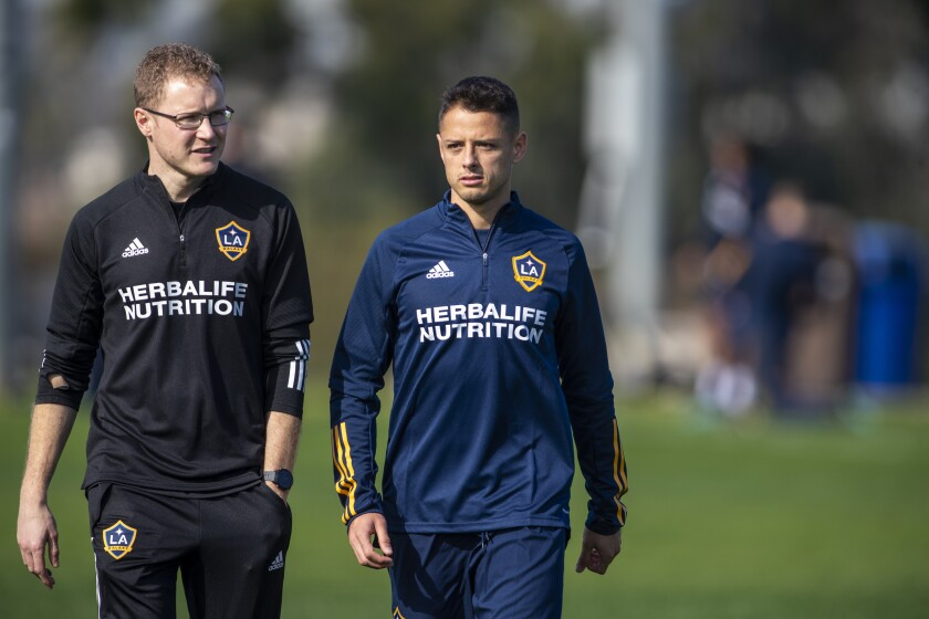 "The Galaxy's Javier ""Chicharito"" Hernández, right, walks with team sports science employee Phil Hayward before a news conference Jan. 23, 2020."