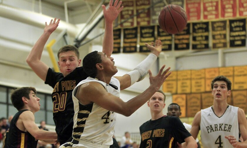 Francis Parker's Andrew Cross is closest to a loose ball with defense provided by Torrey Pines' Jack Bailey, left.