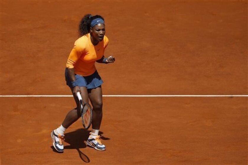 Serena Williams from U.S. celebrates a point against 2Yulia Putintseva from Kazakhstan during the Madrid Open tennis tournament, in Madrid Sunday, May 5, 2013. (AP Photo/Daniel Ochoa de Olza)