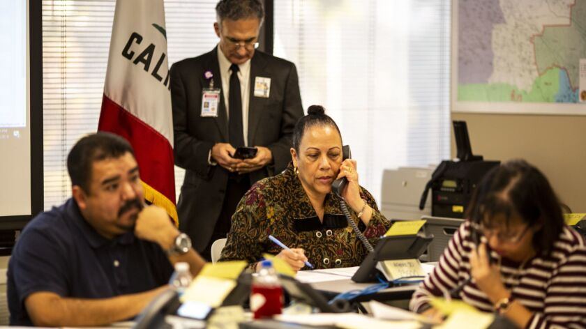LOS ANGELES, CALIF. - JANUARY 10: Robert Partida, an IT Support representative, Lisa LaCoste Clayton