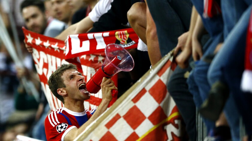 Bayern's Thomas Mueller celebrates with fans after winning 6-1 during the soccer Champions League qu
