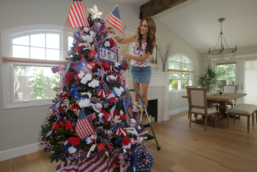 Nadia Colucci decorates her Christmas tree to celebrate the 4th of July Monday, 06/29/20.