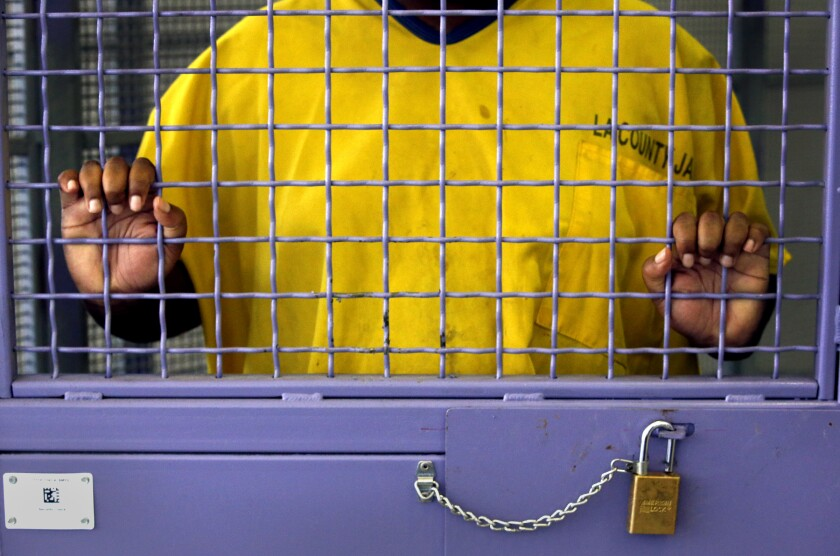 An inmate stands in his cell in the High Observation Mental Health unit of L.A. County's Twin Towers Correctional facility