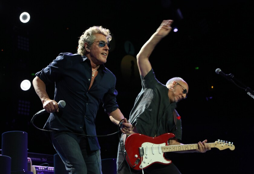 Lead singer Roger Daltrey, left, and lead guitarist Pete Townshend of The Who perform at the Honda Center in Anaheim on the group's 50th anniversary tour.