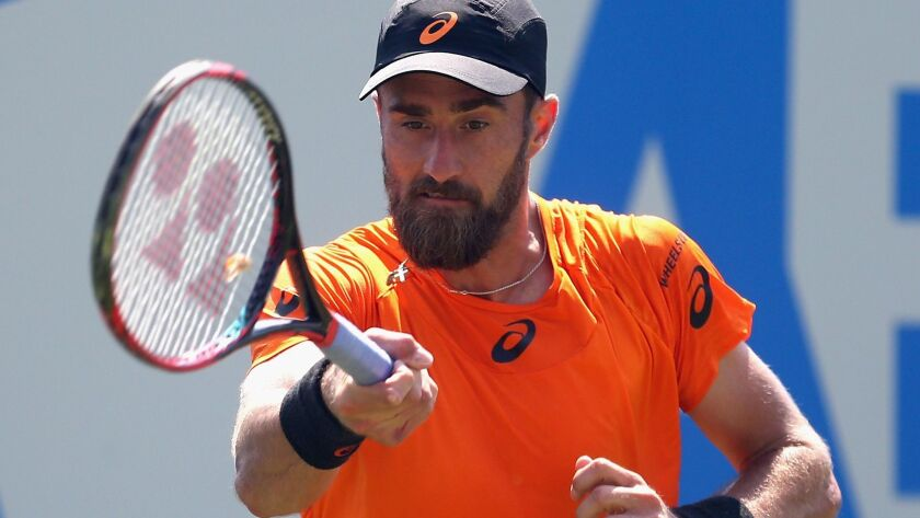 LONDON, ENGLAND - JUNE 20: Steve Johnson of The United States plays a forehand during mens singles
