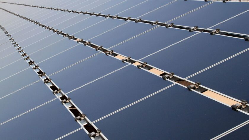 FILE- This April 20, 2011, file photo shows some of the 30,000 solar panels that make up the Public