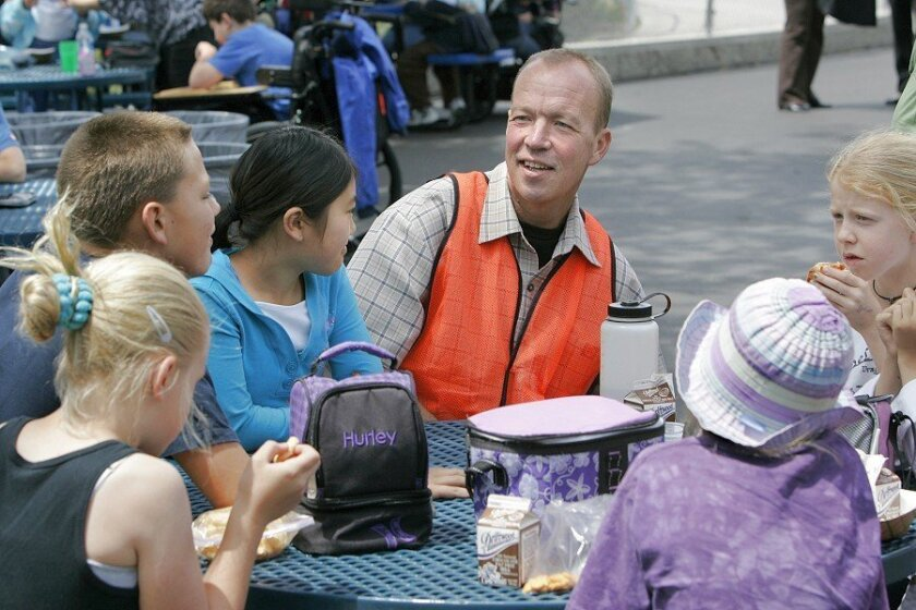 Teacher David Skinner chats with students (from left) Alexa Hatt, Jake Gilliam and Sara Nakamura during lunch at Carmel Del Mar School.