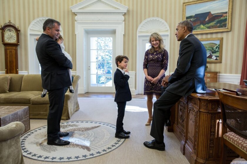 President Barack Obama meets with Alex Myteberi, who was 6 when he wrote President Barack Obama to ask if a young Syrian refugee could live with his family. Here he meets Obama on Nov. 10, 2016. Alex's mother, Valbona Myteberi, father Elton and sister Catherine, joined him.