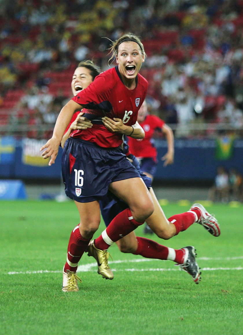 Abby Wambach, front, celebrates with Julie Foudy after scoring in extra time to beat Brazil.