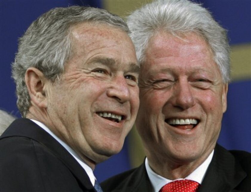 FILE - In this Nov. 13, 2006 file photo, President Bush is greeted by former President Bill Clinton, right, before speaking at the groundbreaking ceremony for the Martin Luther King Jr. National Memorial on the National Mall in Washington. Former President Bill Clinton is busy on the campaign trail, helping candidates in races from Florida to Washington state. His successor, George W. Bush? Holed up in Texas. (AP Photo/Pablo Martinez Monsivais, File)
