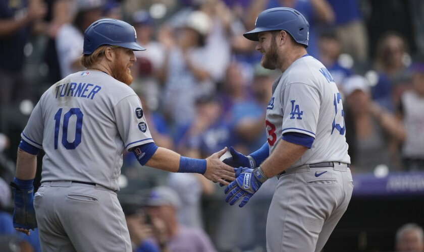 Dodgers' Justin Turner congratulates Max Muncy who crossed home plate.