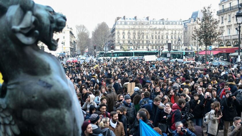 High school students, teachers and parents fill Place Saint-Michel in Paris on Tuesday to protest education reforms.