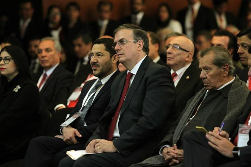The Secretary of Foreign Affairs (SRE), Marcelo Ebrard (c), attends the inauguration of the XXX Meeting of Ambassadors and Consuls hosted Monday at the headquarters of the Foreign Ministry, in Mexico City (Mexico). Jan. 7, 2018. EPA-EFE/SRE/EDITORIAL USE ONLY