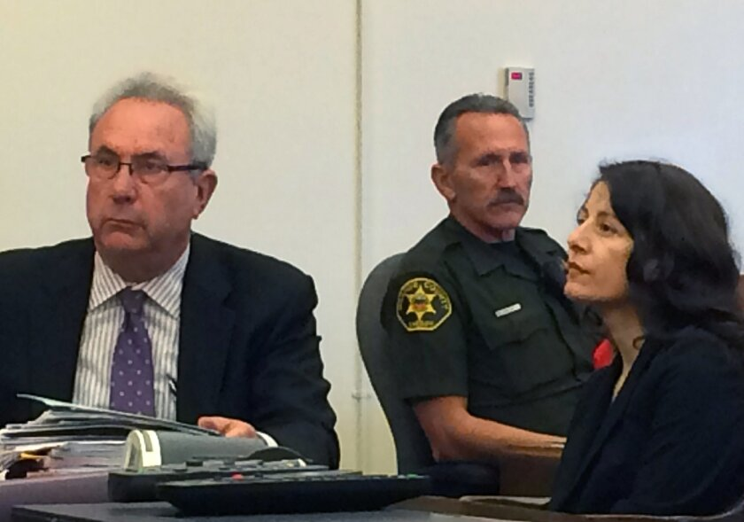 Norma Patricia Esparza sits during her sentencing hearing with her attorney, Jack Earley on Friday, July 15, 2016, in Santa Ana, Calif. Esparza a former psychology professor was sentenced Friday to six years in prison for the 1995 killing of a man she says raped her while she was a Southern Califor