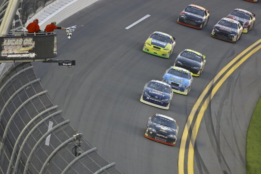 John Wes Townley, front right, takes the checkered flag to win the ARCA series auto race at Daytona International Speedway, Saturday, Feb. 13, 2016, in Daytona Beach, Fla. (AP Photo/David Graham)