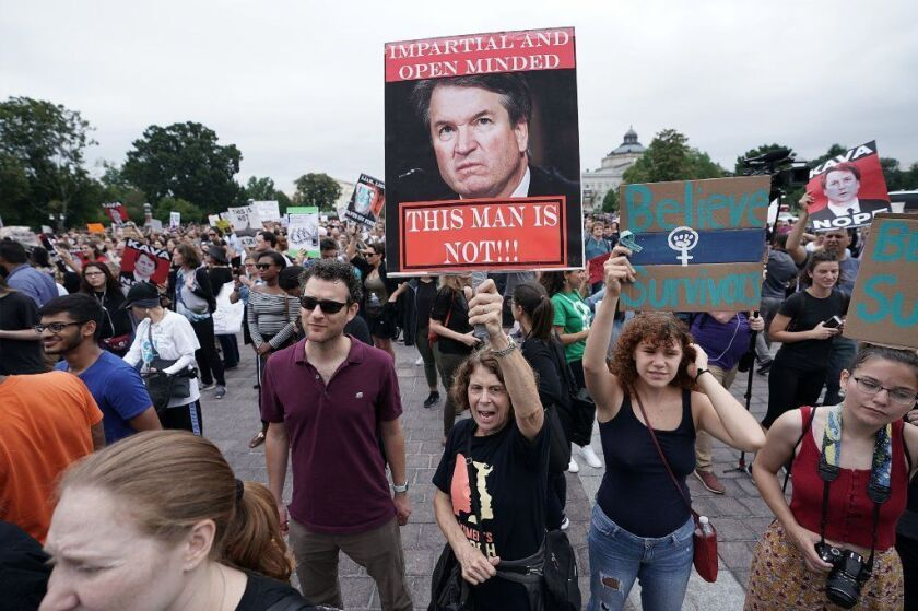Demonstrators protest the confirmation of Brett Kavanaugh to the U.S. Supreme Court in Washington,
