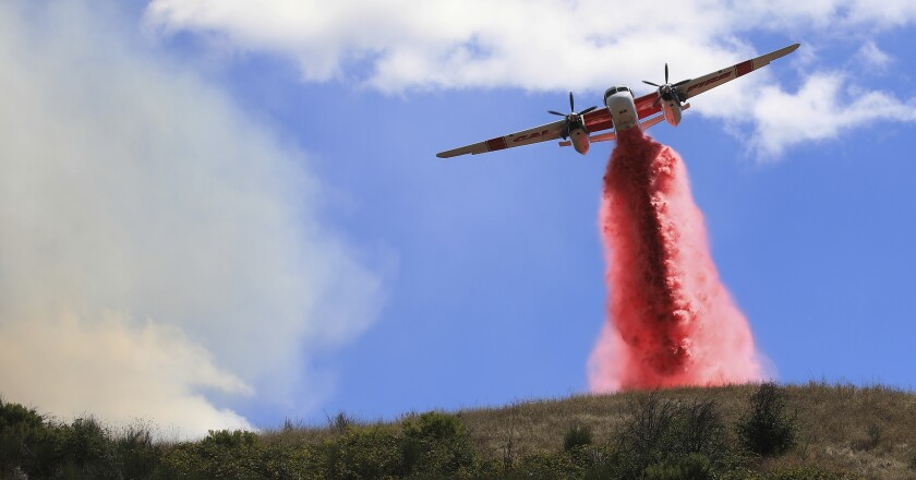Cal Fire air tankers help stop the spread of a brush fire in Larkfield Calif.