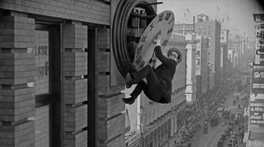 "Harold Lloyd hangs from a giant clock in this iconic scene from his 1923 silent film ""Safety Last!"""