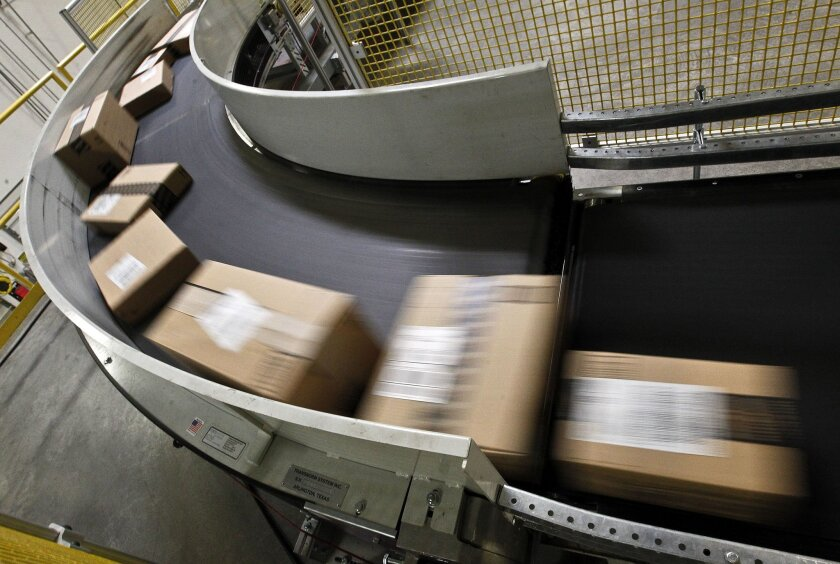 FILE - In this  Monday, Nov. 26, 2012, file photo. packages are ready to ship move along a conveyor belt at the Amazon.com 1.2 million square foot fulfillment center, in Phoenix.  Millions of shoppers are expected to click on items on Monday, Dec. 2, 2013,  as retailers rev up deals to grab online