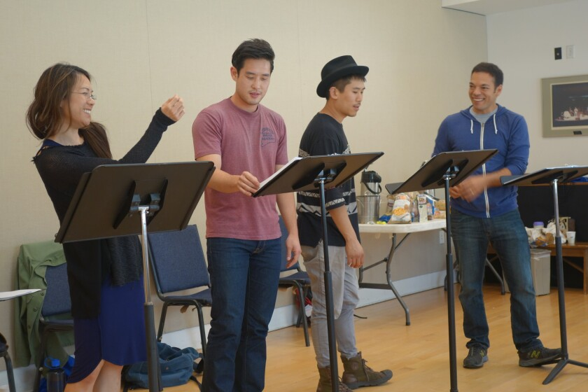 """Samantha Quan, Raymond Lee, from left, Lawrence Kao and Paco Tolson rehearse for SCR's upcoming """"Vietgone"""" by Qui Nguyen."""