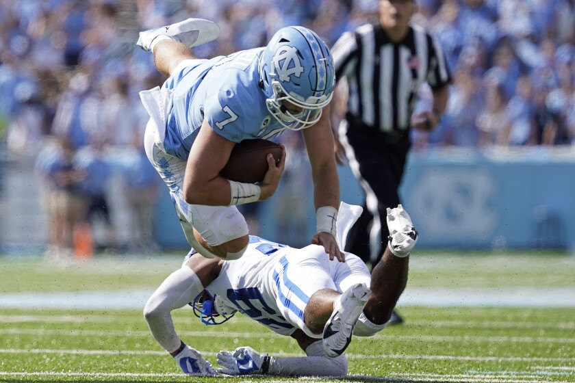 North Carolina quarterback Sam Howell (7) is tackled by Duke linebacker Shaka Heyward (42) during the second half of an NCAA college football game in Chapel Hill, N.C., Saturday, Oct. 2, 2021. (AP Photo/Gerry Broome)