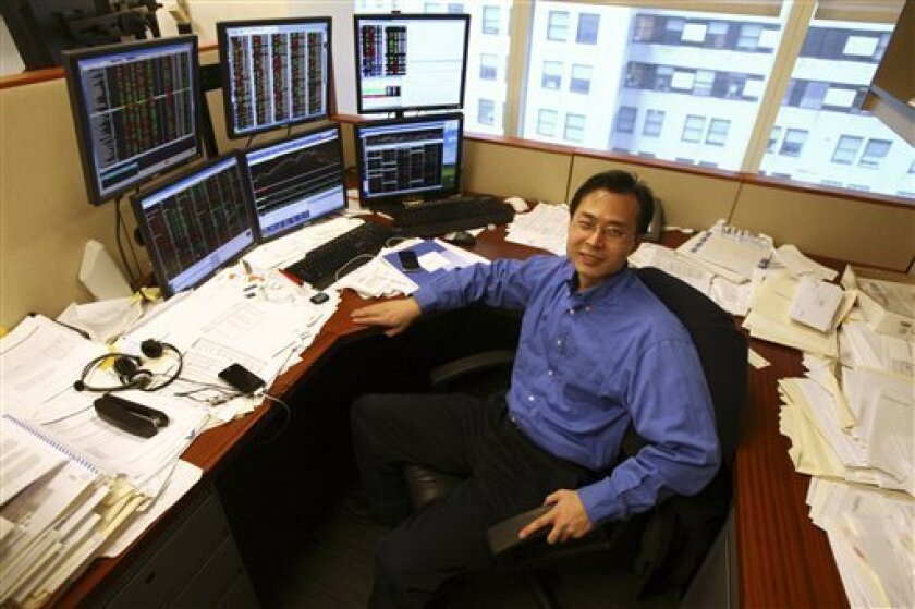 Chris Wang, founder and portfolio manager of New York-based SYW Capital Management, poses for a portrait in his office, Thursday, Jan. 8, 2009 in New York.  (AP Photo/Mary Altaffer)