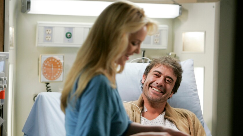 """Jeffrey Dean Morgan as Denny Duquette, the doomed heart transplant patient, on ABC's """"Grey's Anatomy"""" (pictured with Katherine Heigl's Izzie Stevens)."""