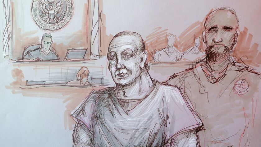 In this courtroom sketch, Cesar Sayoc, left, appears in federal court, Monday, Oct. 29, 2018, in Mia