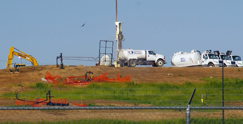 In this May 22, 2013, file photo crews works to contain odors from a slow-burning underground fire smoldering near a cache of nuclear waste at the Bridgeton Landfill in Bridgeton, Mo.
