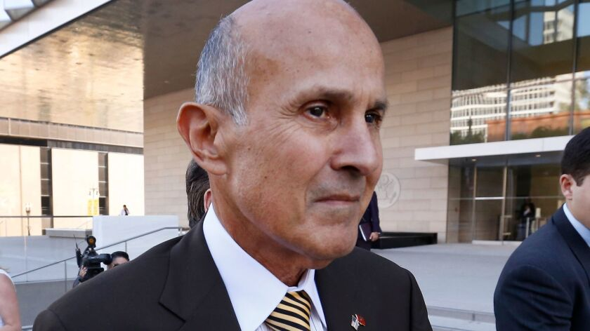 LOS ANGELES, CA - MARCH 15, 2017 - Former Los Angeles County Sheriff Lee Baca departs from the Los A