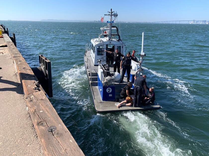 National City and Harbor police officers rescued a man who fell off a jet ski in San Diego Bay on Monday.