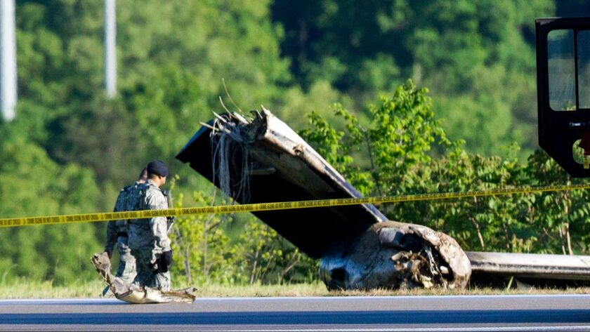 Part of a cargo plane lies on the ground following a fatal crash at Yeager Airport in Charleston, W.Va., on Friday.