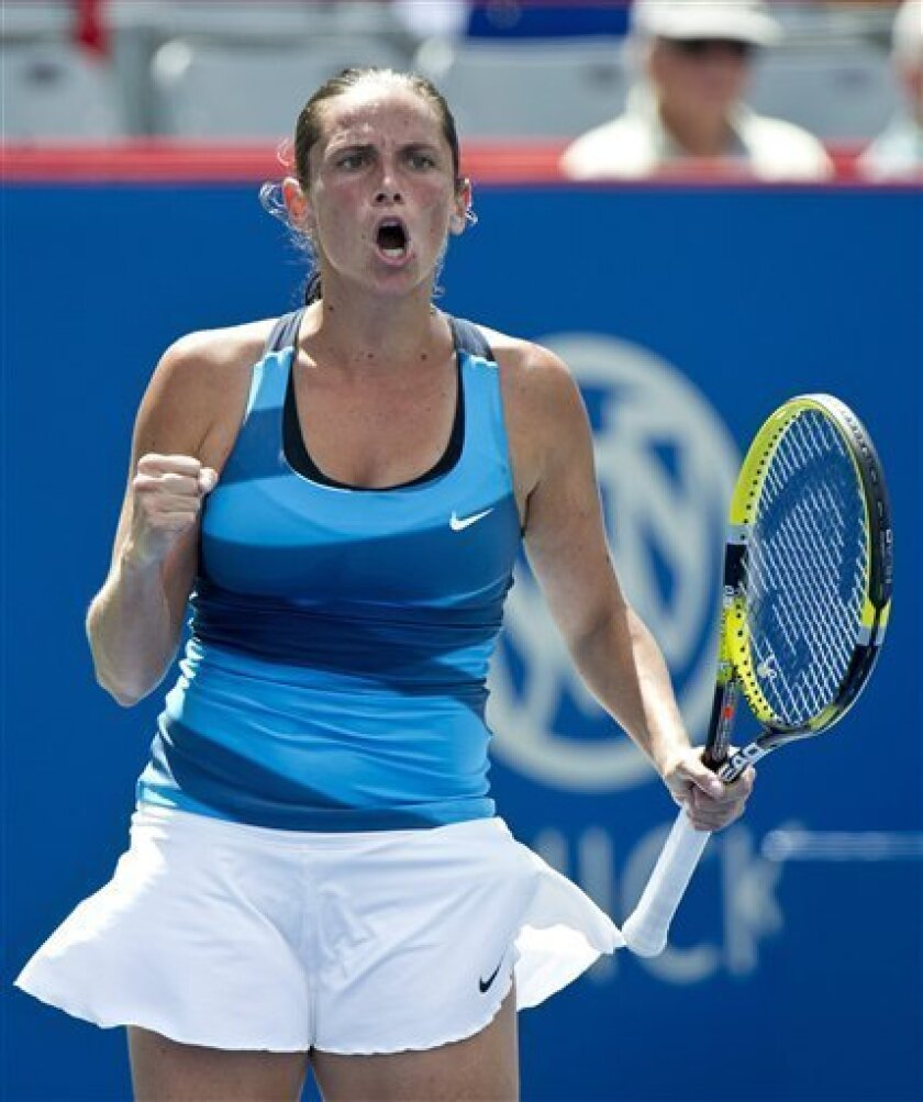 Roberta Vinci from Italy, reacts during her match against Yanina Wickmayer from Belgium,  during first round of play at the Rogers Cup women's tennis tournament, Tuesday, Aug. 7, 2012, in Montreal. Vinci won 6-2, 3-6, 7-5. (AP Photo/The Canadian Press, Paul Chiasson)