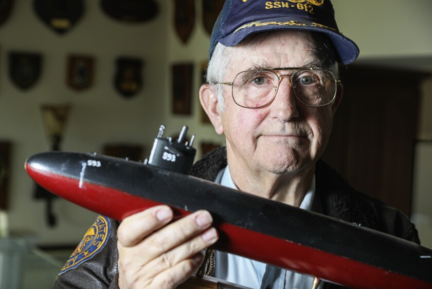 Retired submarine captain Jim Bryant holds a model of the Thresher. The 1963 sinking of this nuclear-powered vessel cost the lives of 129 men, the worst submarine disaster in the U.S. Navy's history.