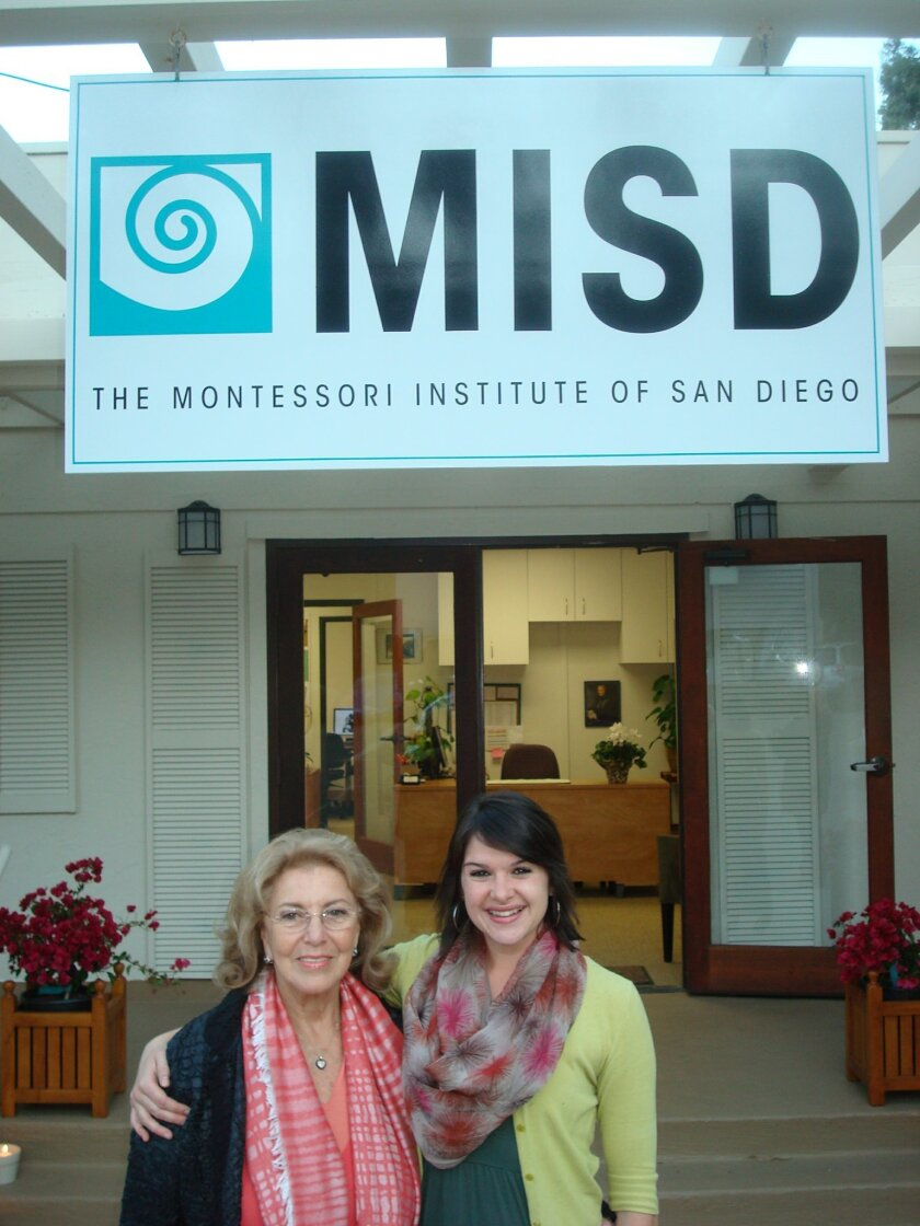 Dr. Silvia Dubovoy and Chelsea Swenson pose at the entrance to The Montessori Institute of San Diego. Courtesy photo