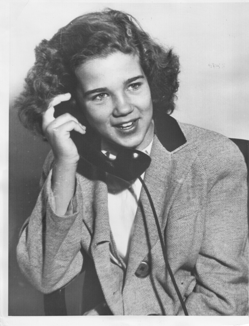 From 'The Real Lolita': Sally Horner on the telephone with her family hours after her rescue. She'd been missing for almost two years.