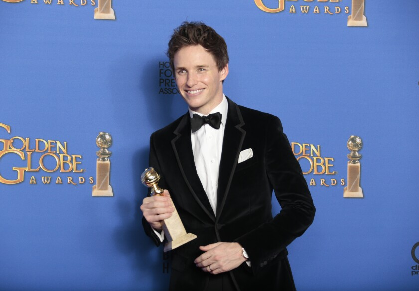 "Eddie Redmayne in the press room with his lead actor in a drama award for his performance in ""The Theory of Everything."""