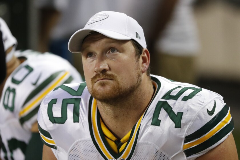 Bryan Bulaga sits on bench during Packers-Giants game last season.